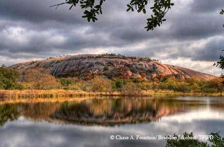 Enchanted Rock reflected in Moss Lake.