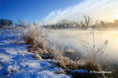 A winter fog rises from a Panhandle pond along the Canadian River north of Pampa.