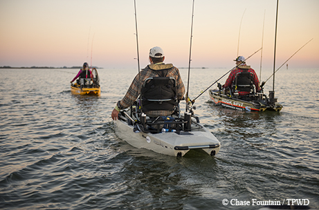 Anglers use pedal kayaks to reach fishing hot spots on the for Fishing kayak with pedals